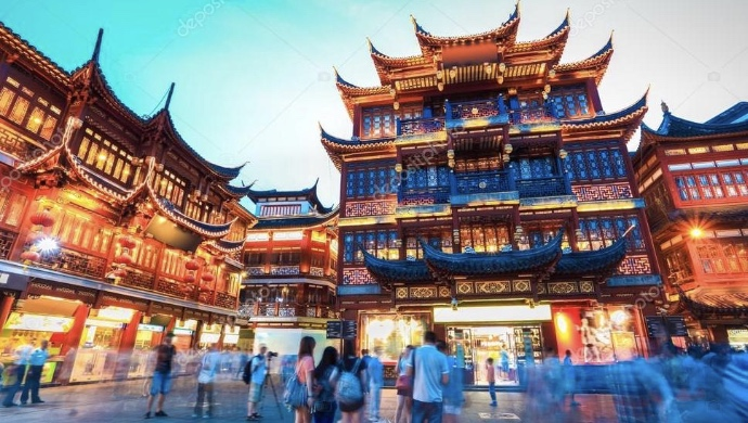 Ming and Qing architecture around  Yu Garden in Shanghai with tourists moving around