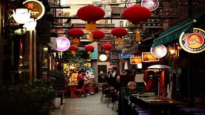 pubs' tables under awnings in historical Chinese Shikumen houses in TianZiFang in Shanghai