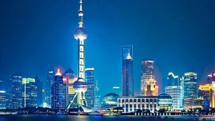 night view of futuristic Shanghai skyline with Oriental Pearl Tower