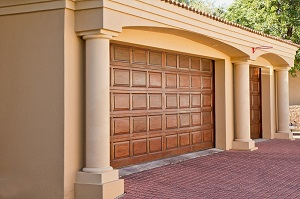 residential villa with wooden garage door and wooden entry door identic pattern