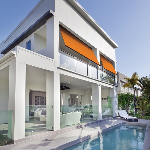 white modern villa with pool and original color monoblocs awning system