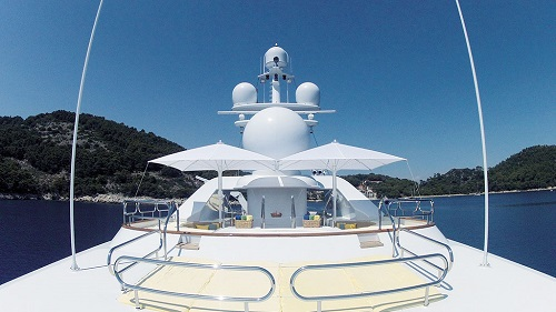 refined selection of white sun shading parasols on yacht