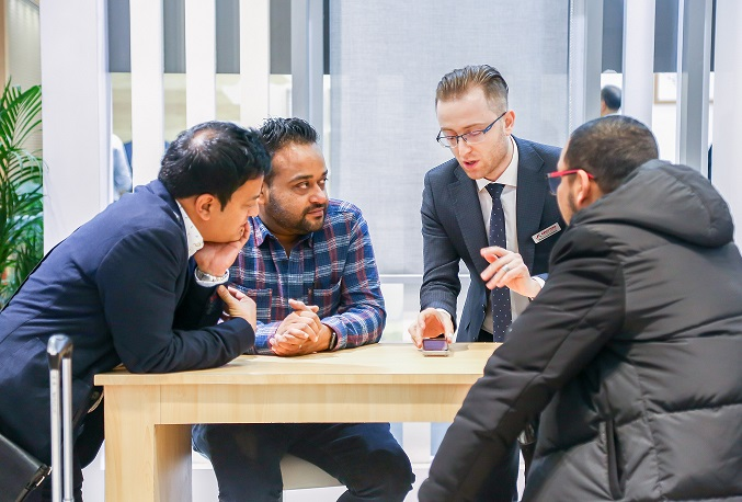 exhibitor demonstrates products to asian customers during R+T Asia trade show